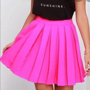 Pleated neon pink skirt
